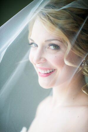 Smiling Bride Under Her Veil