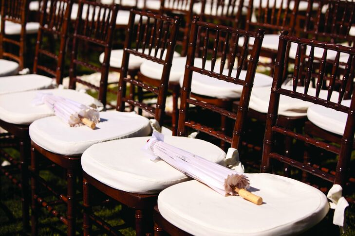 Guests found parasols on their cherrywood chiavari chairs to protect them from the sun during the ceremony.