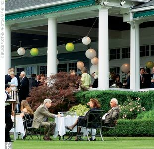 The cocktail hour was held on the country club's lawn and large porch, which was decorated with green and white paper lanterns.