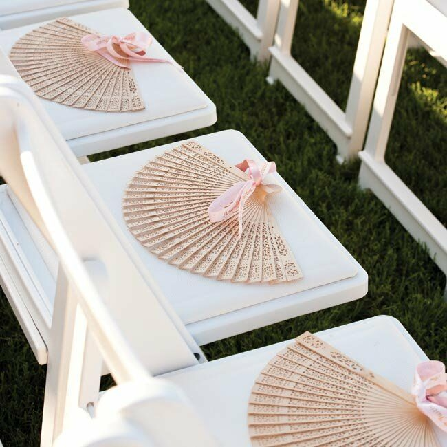 A fan tied with custom-printed pink ribbon greeted each guest at their ceremony seat.
