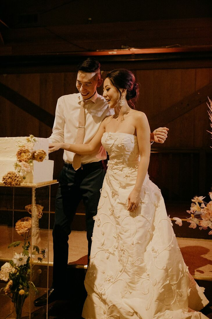 Modern, Whimsical Cake Cutting with Bride and Groom