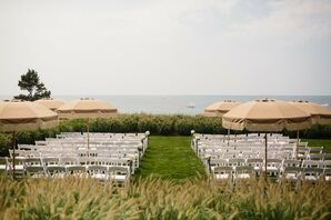 Waterfront Ceremony with Umbrellas and Folding Chairs