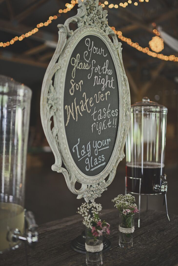 As guests entered the reception, they passed a station to tag their mason jars for the night with their names.