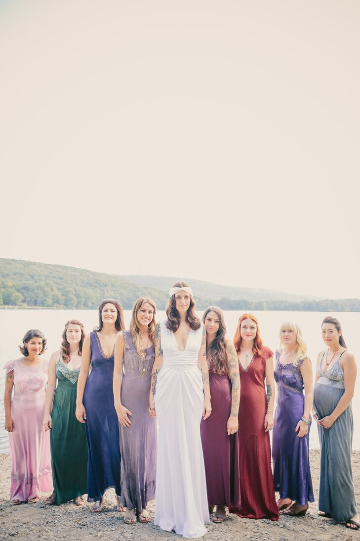 Andrea stood in the front of her bridesmaids, who wore vintage slip dresses in a variety of styles and colors. Andrea wanted her bridesmaids to pick a color they wanted, so after purchasing the dresses, they were brought to Olive's Very Vintage and dyed whichever color was desired.