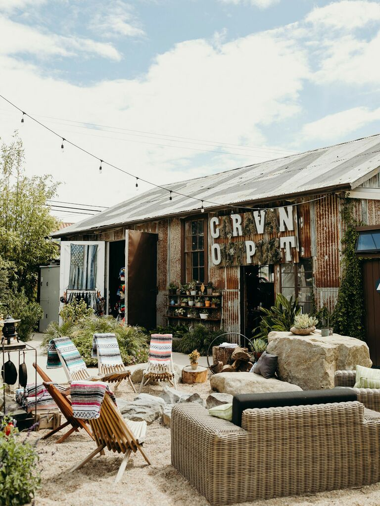 DIY-themed wedding with custom seating area at outdoor barn venue