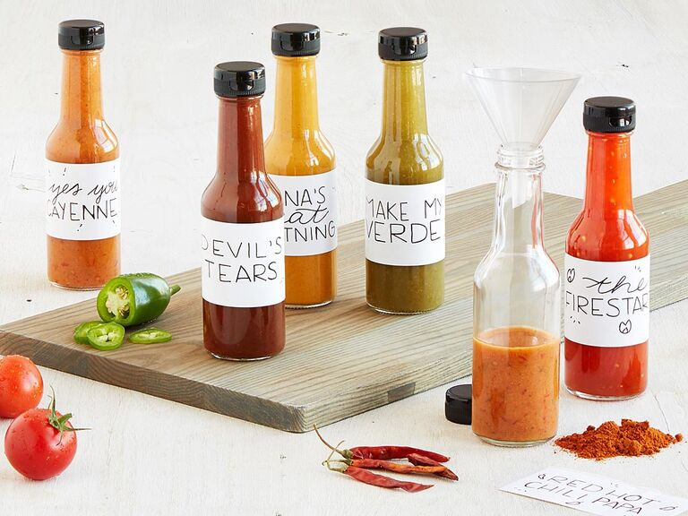 Hot sauce making kit showing labeled bottles with different color sauces inside