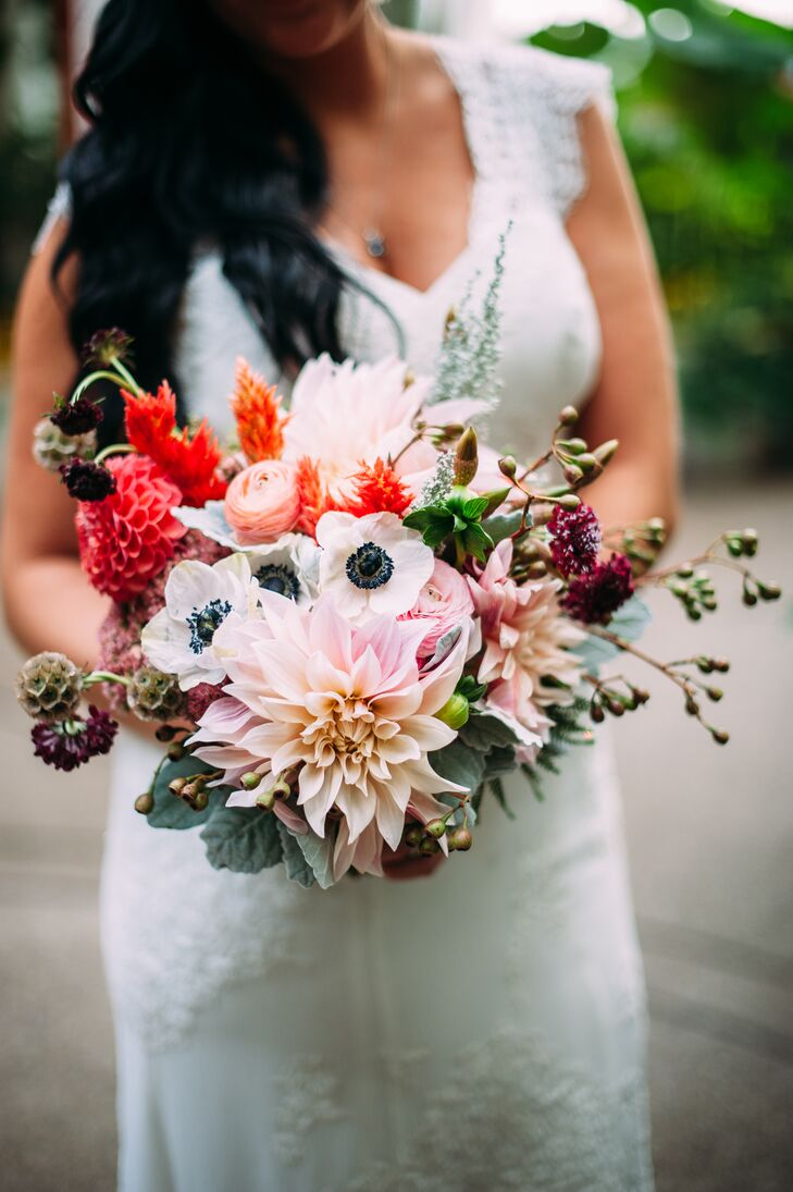 April held a colorful bouquet with an assortment of white dogwoods, coral ranunculus and many other wildflowers selected and arranged by Mt. Lebanon Floral.