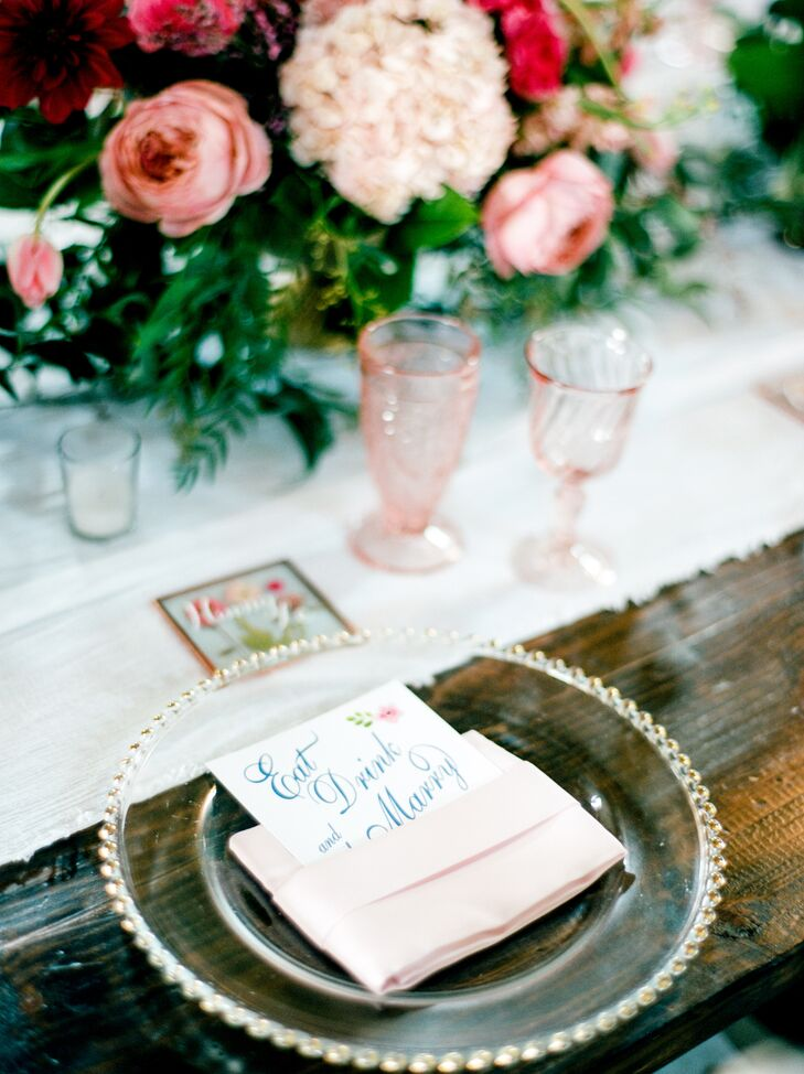 Blush pink glassware and ranunculus were paired with the rich, leafy green centerpieces. Each guest took home a hand-pressed floral coaster.