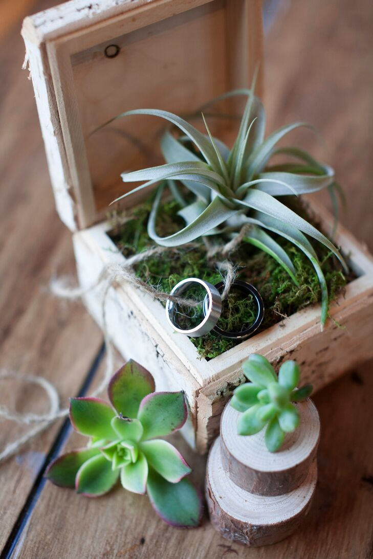 To play up the mountain theme, David and Jeremy's ring bearer presented their wedding rings in a small birch box lined with a soft bed of moss and a single air plant.