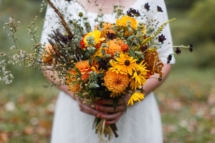Wildflowers were accented with pops of orange dahlias.