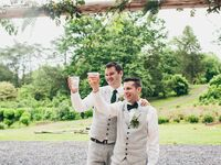 Grooms toasting after wedding speeches.