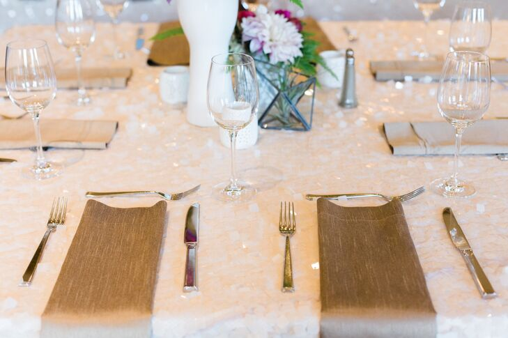 Gilded linen napkins topped pale gold sequined linens at some of the reception tables.