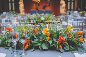 Centerpieces with Greenery and Orange and Yellow Flowers