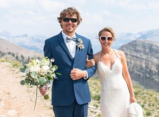 Shannon Brady and Pat Calhoun's summer wedding in the Teton mountains had a rustic, bohemian vibe with natural wood accents and a color palette of war