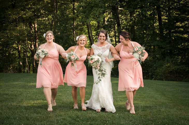 Samantha's three bridesmaids wore matching halter, knee-length, peach bridesmaid dresses and paired them with matching nude wedges. They styled their hair with simple updos with white flowers.
