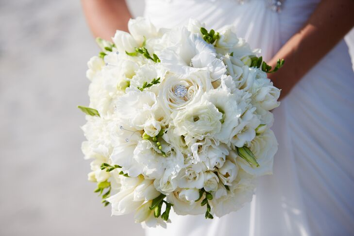 """""""My bouquet was composed of a variety of full white flowers including roses, freesia, glad blooms, rannunculus, tulips, lisianthus with a touch of sparkle,"""" says Stephanie."""