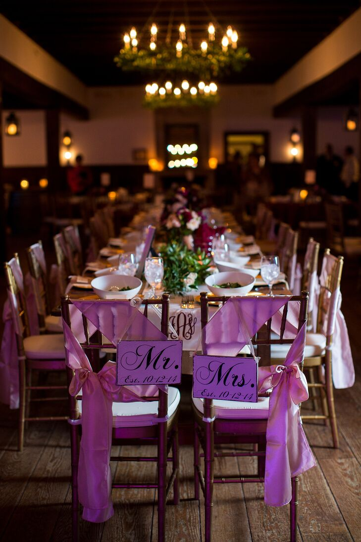 "The married couple had seats at the head of the table with ""Mr."" and ""Mrs."" signs, which complimented the rest of the purple accents."