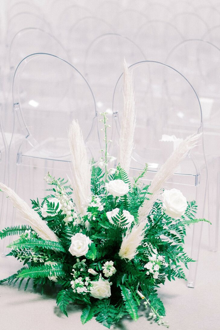 Modern Flower Arrangement with White Roses, White Grasses and Leaves