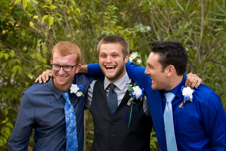Christian wore a dark blue vest with a silver collared dress shirt underneath, accented with a blue tie that went along with the color scheme. His groomsmen stood beside him, wearing collared shirts and ties that were blue as well.