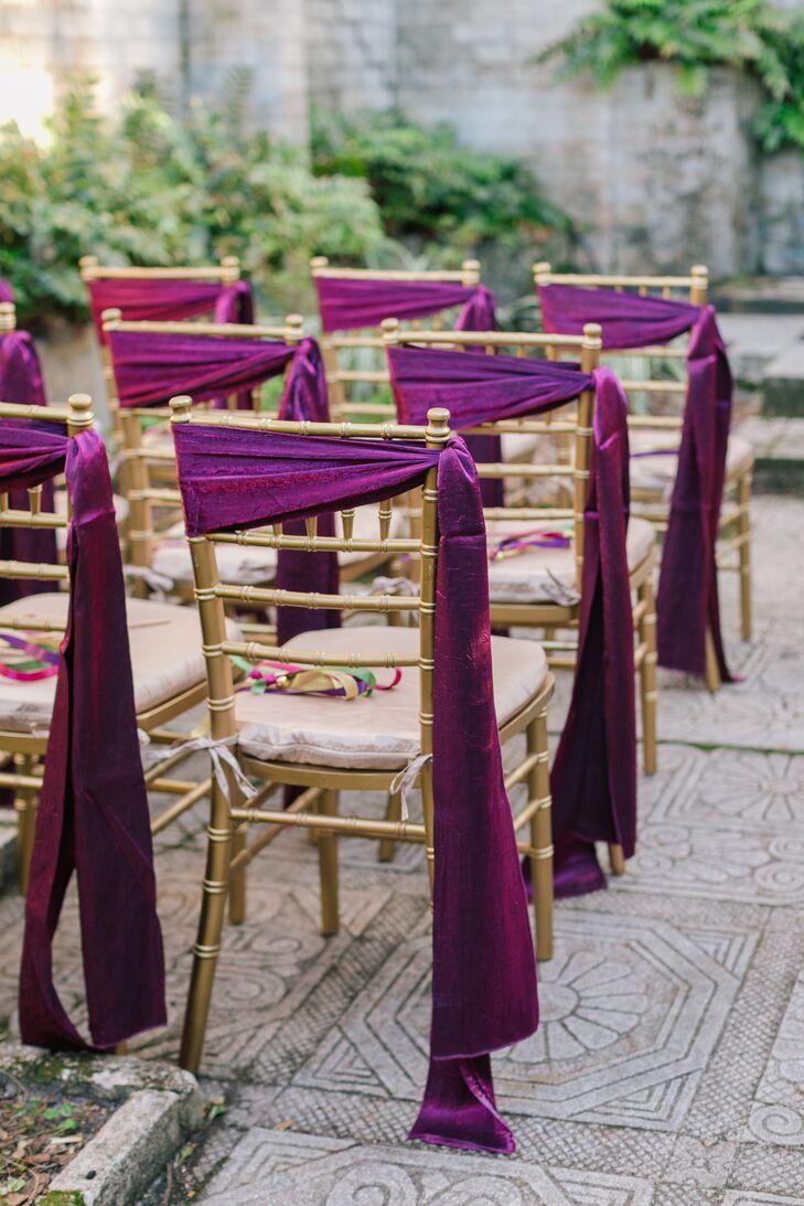 Draped Purple Sashes Tied Around Chairs