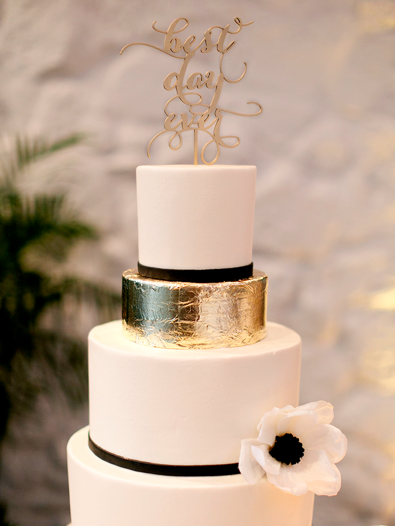 Black and white wedding cake with an accented gold foil tier
