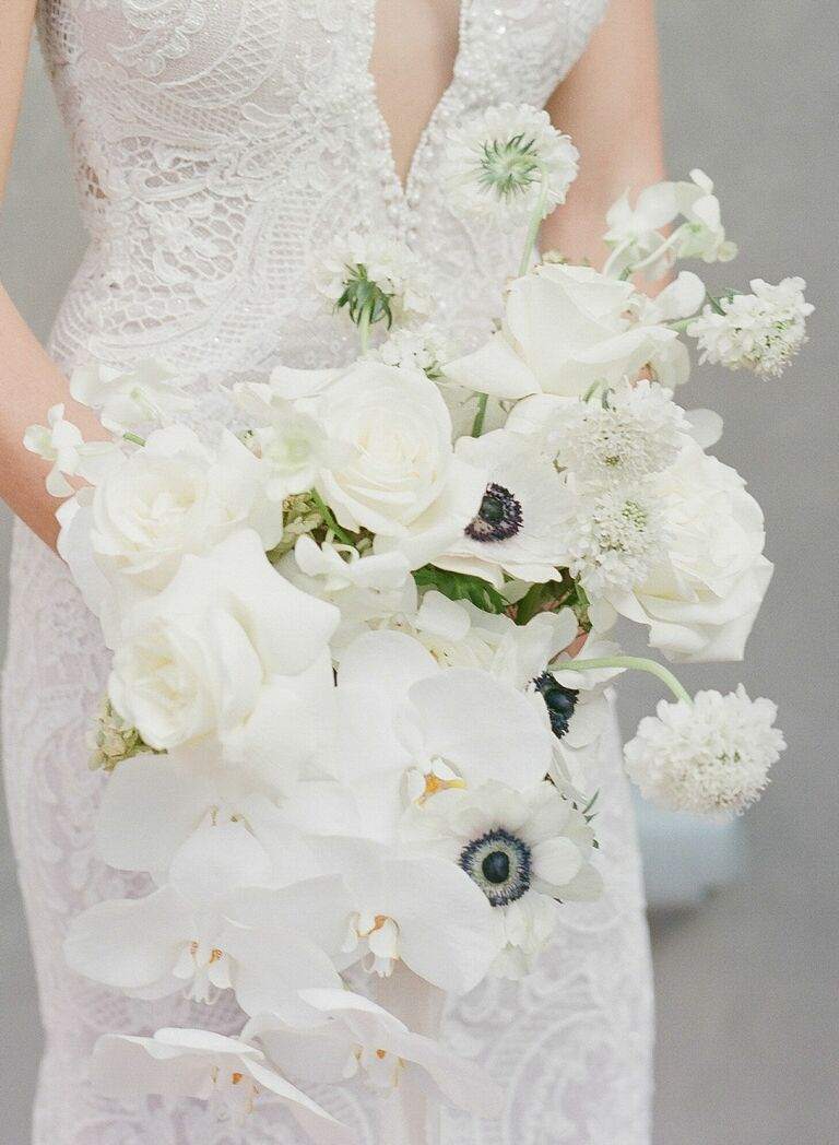 White bouquet with orchids, scabies and anemones