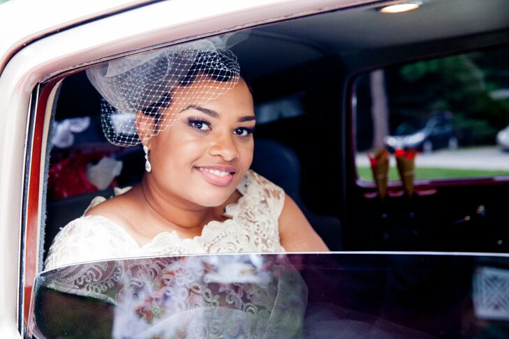 Sicilia rolled down the window and smiled as she traveled to the next part of the wedding day. She wanted to incorporate a touch of vintage into her look, and did so with a white netting birdcage veil.