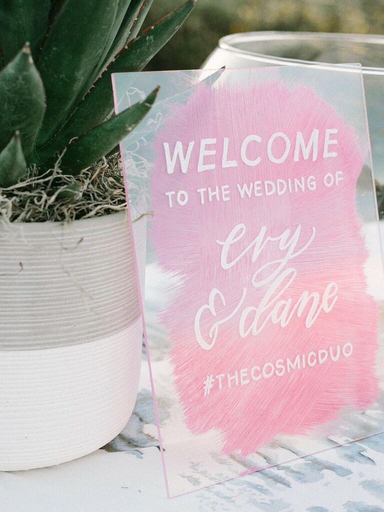 Custom wedding signage with hashtag on glass