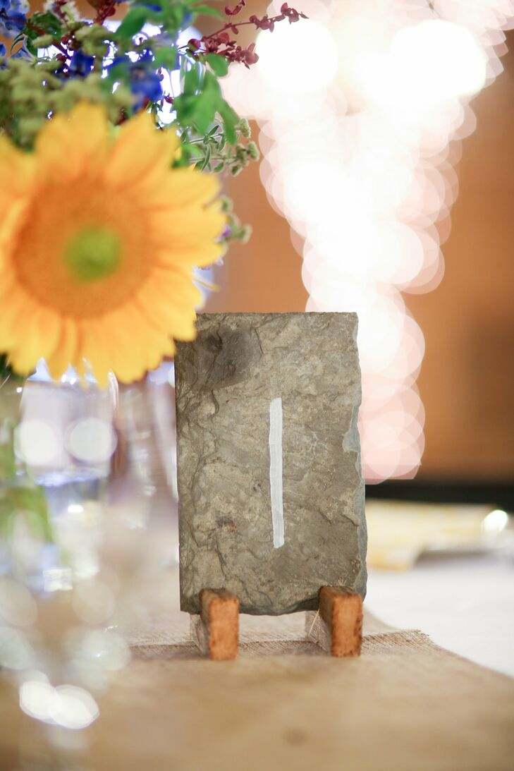 Slate table numbers complemented the earthy, organic vibe of the reception decor.
