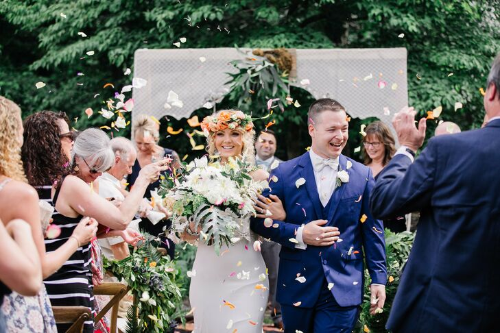 Bohemian Couple Recessing at Backyard Wedding with Petal Toss