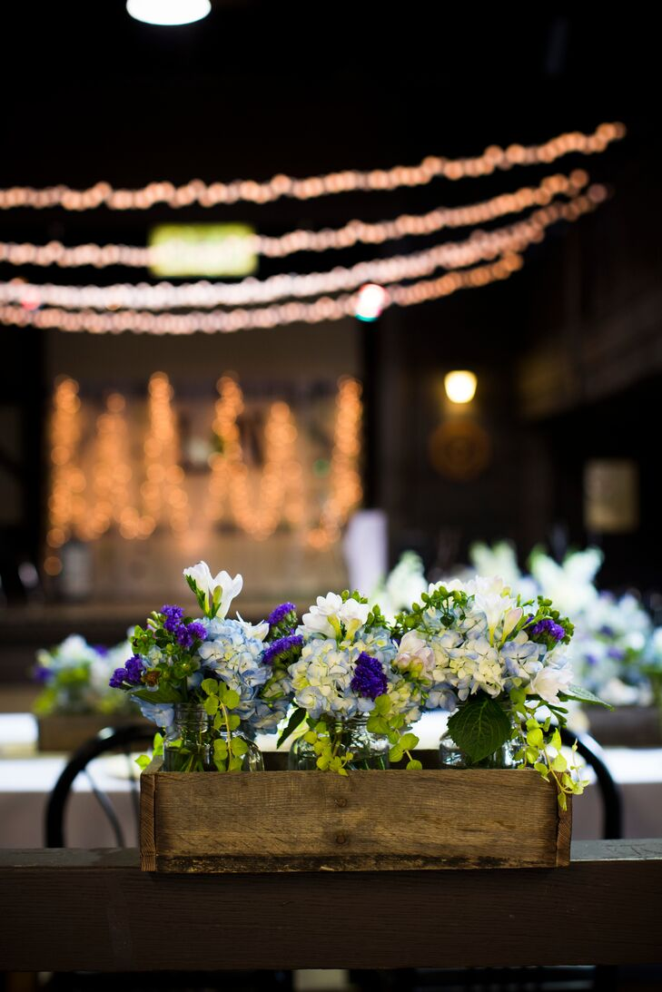 """""""With the help of Katie they put all our flowers the day before,"""" says Linsey. """"These included wooden boxes with mason jars full of blue and white hydrangeas, purple statice, white larkspur and lavender."""""""
