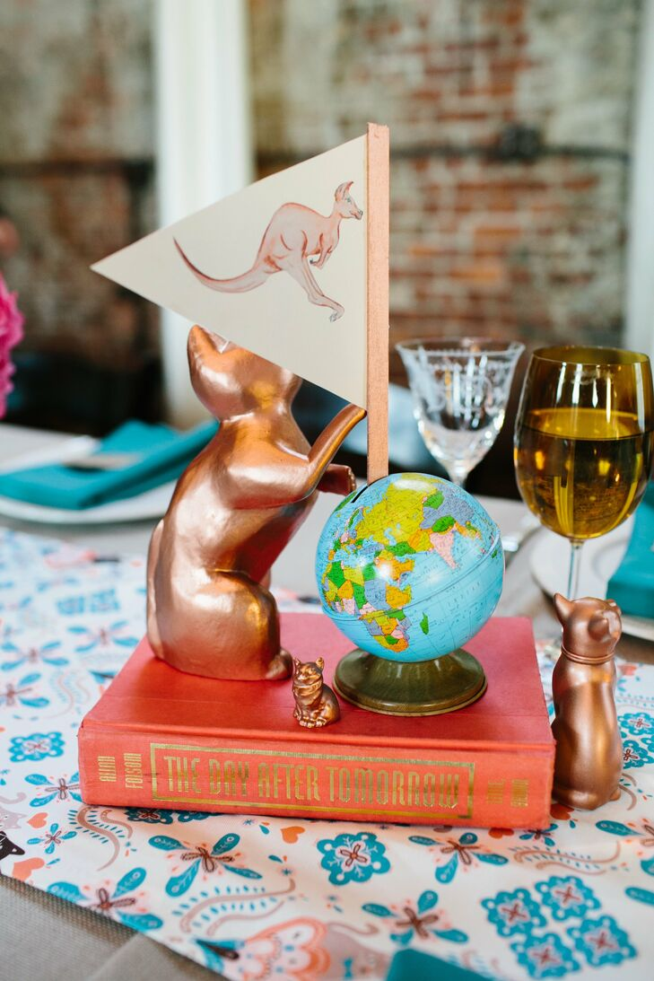 Bronze cats in various sizes played into one of the day's quirky motifs and added a playful touch to the centerpieces.
