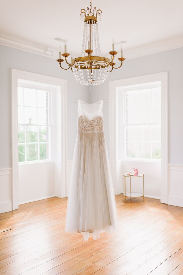 """""""Part of my look really evolved from practicality,"""" says Jennifer, who chose a Willowby by Watters gown at BHLDN that had an illusion neckline, a lace bodice and a tulle skirt. """"I knew I didn't want a strapless gown, since I didn't want to have to keep tugging at it throughout the evening."""""""