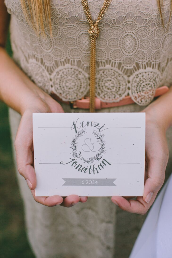 All the stationery was designed by Kenzi. To create continuity between the wedding's invitations and the rest of the paper goods used throughout the day, she used the couple's whimsical, organic monogram—complete with hand-lettering and a floral wreath—on the ceremony programs as well as the table numbers.