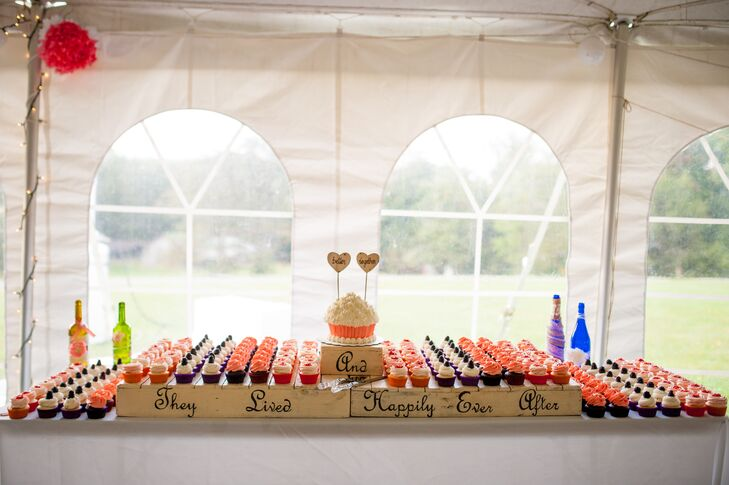 "Instead of a traditional cake, Megan and John served their guests an array of cupcakes for dessert. They also had a sweetheart cake shaped like a cupcake. The desserts were displayed on a table with a rustic sign that read ""And they lived happily ever after."""
