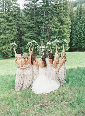 Long Patterned Bridesmaid Dresses and White Bouquets