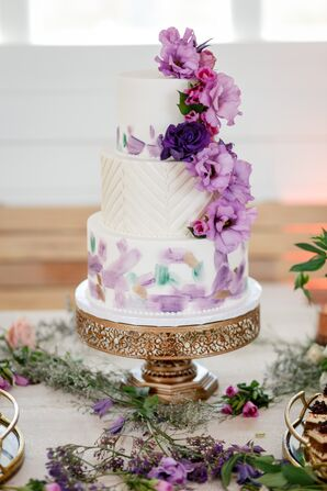 Round Tiered Cake with Purple Cake Flowers and Watercolor Accents