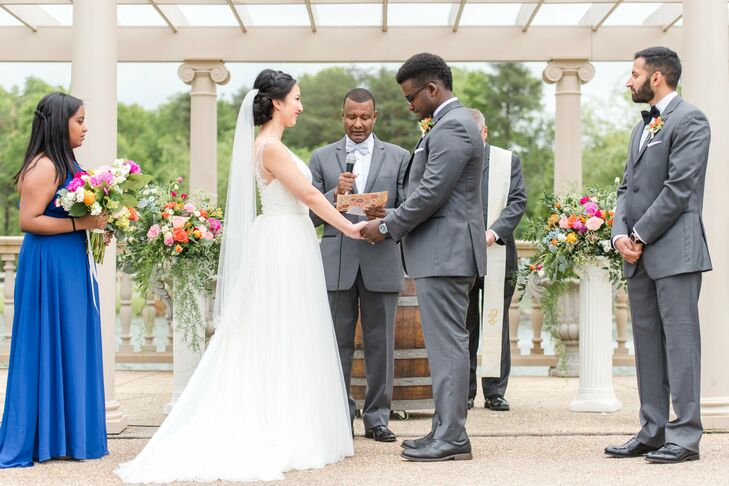 Along with acoustic guitar music, the couple incorporated hand-tying and wine-pouring rituals into their outdoor ceremony.
