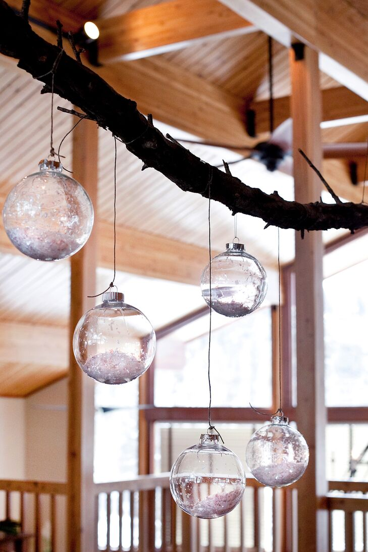The reception was decorated with hanging glass Christmas ornaments filled with white glitter to look like snow.
