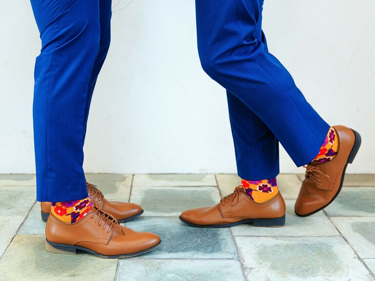 Grooms wearing matching wedding shoes and socks