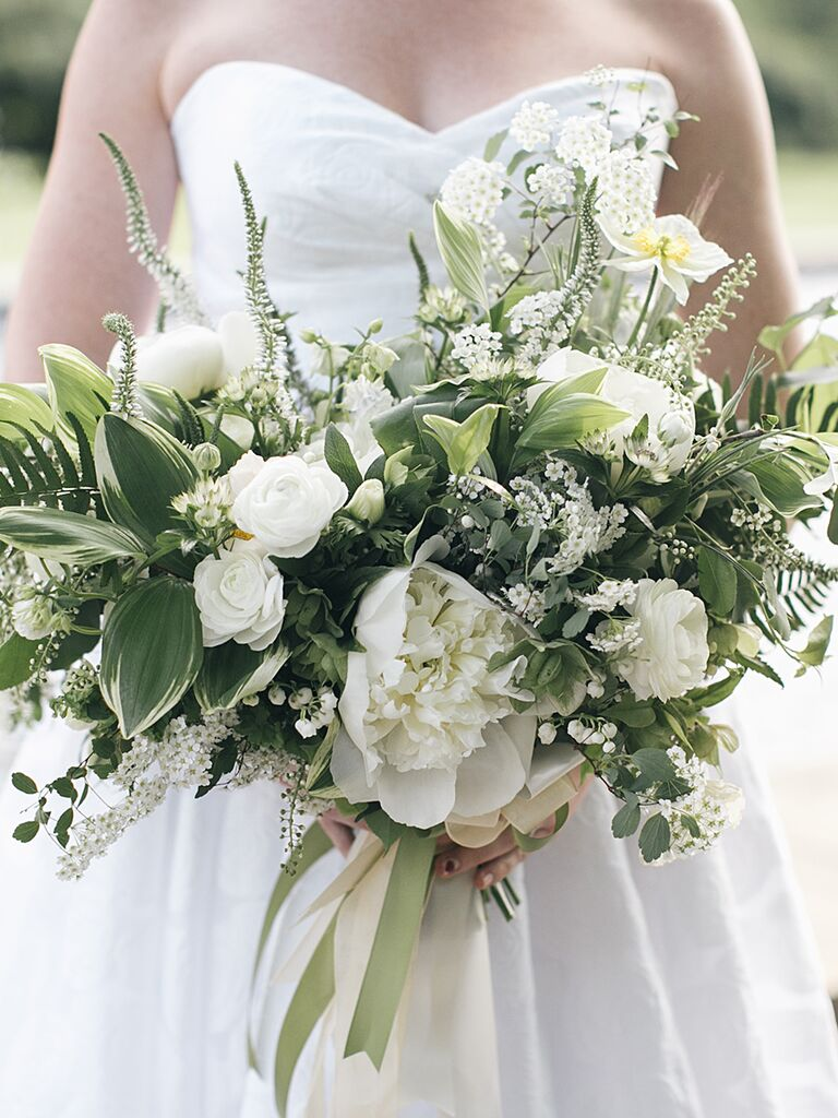 The prettiest greenery bouquets weve ever seen a bridal bouquet with peonies and ranunculus izmirmasajfo