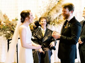 Bride and Groom Exchanging Vows in Front of Officiant