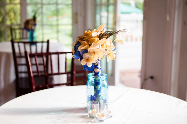 Alison's bridesmaids carried bouquets of burlap flowers with peacock feather accents and blue ribbon.
