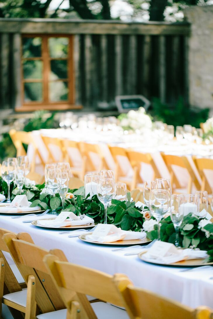 In October, Carmel Valley is golden all over as it's transitioning into the fall. The bride wanted to keep the decor romantic and clean so it wouldn't compete with the natural surroundings.  All of centerpieces were a variety of seasonal white flowers with big green leafing detail.