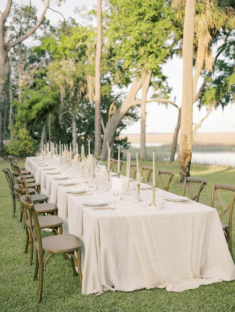Neutral waterfront tablescape with wood cross-back chairs