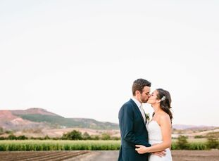 Vibrant jewel tones, watercolor accents and wild, romantic florals gave Lindsay Merfeld (31 and a nonprofit event manager) and Michael Angrisani's (33