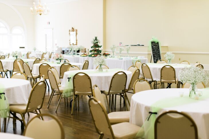 White linens and mint tulle accents decorated the dining tables in the reception hall at First Presbyterian Church in Macon, Georgia, for Ginnie and Tyler's dessert reception.