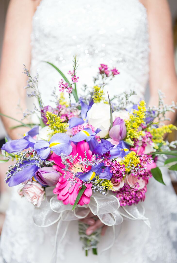 Matthew's eldest daughter's dress was the inspiration for their vibrant blue and green color palette. Tricia showed her florist a picture of the dress and asked for colorful local blooms that popped against the rich tone.