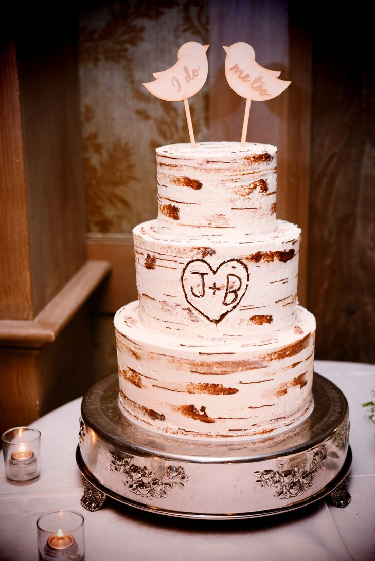 The cake was a three-tiered rustic confection made to look like a birch tree etched with Jessica and Barbara's first initials.rn