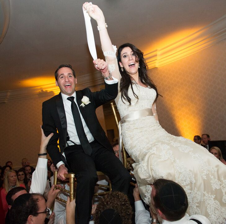 During the reception, the couple was lifted up by their friends and family for a traditional hora.